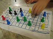硯硯與堯堯:融合五子棋與跳棋的創意棋局